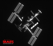 Telescopic ground-based image of the International Space Station in orbit, taken with MARS satellite tracking software and sensors. (Notice the Space Shuttle Atlantis docked at bottom.) Speed 28,000 km/hour, Distance 350 km. Many 'claim' to photograph satellites: Ask to see their images. MARS invites you to compare our data.